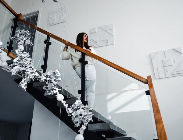 Rifat Ishpa Shah standing on stairs with cute white outfit